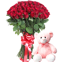 Eternal Flame of Beautifully Arranged Freshest Flowers along with a Teddy